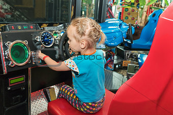 Little girl on the game simulator