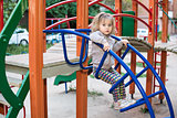 Girl on the stairs at playground