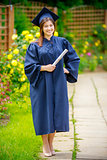 Graduated young woman smiling at camera