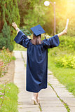 Young woman in graduation day celebrating