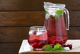 Organic cherry lemonade with fresh berries on the table