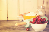 Mixed berries, baking ingredients and utensils
