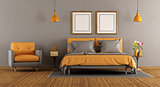 Modern gray and orange bedroom