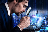 Man looks at the magnifying glass a laptop. Concept of software analysis