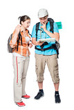 Couple of tourists arguing and looking for a path on a map on a