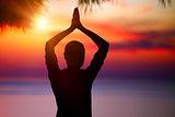 Doing yoga on sunset
