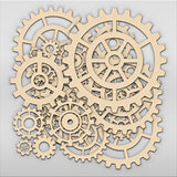 Gears from clock works over light grey metalic plate