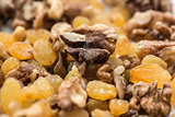 raisins and walnuts closeup background