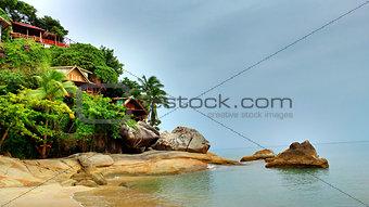 Houses on cliff near the beach