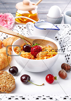 Breakfast with cornflakes berry honey light croissant