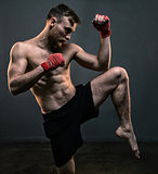 Bearded fighter during hard workout