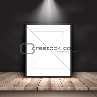 Blank picture leaning against chalkboard