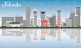 Fukuoka Skyline with Gray Landmarks, Blue Sky and Reflections.
