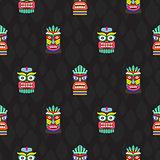 Colorful tiki masks totems seamless dark pattern vector.