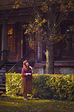 Girl standing near old house