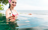 Woman in vacation relaxing swimming in pool