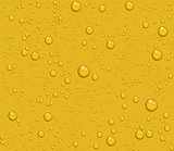 Light beer transparent drops of dew on yellow background