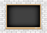 Blackboard on white brick background