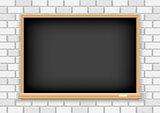 Blackboard on white brick background