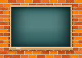 Blackboard on red brick background