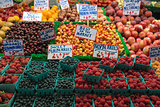 Fresh Fruits and Berries at Fruit Stand in Market