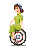 Girl automechanic with vintage car wheel.