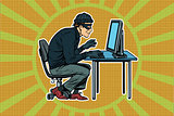 hacker sitting at the computer