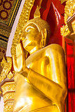 Golden Buddha statue in the church