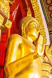 Golden Buddha statue in the church