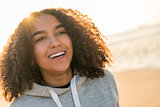 Mixed Race African American Girl Teenager Smiling on Beach at Su