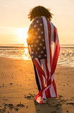 Mixed Race African American Girl Woman Wrapped in US Flag Beach