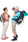 Man tourist with a backpack photographing his girlfriend isolate