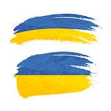 Grunge brush stroke with Ukraine national flag on white