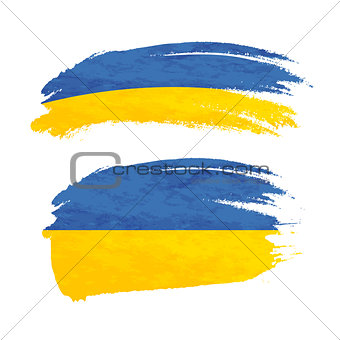 Grunge brush stroke with Ukraine national flag on white