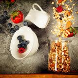 Flying breakfast against grey wall