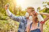 Gardeners taking selfie with respirator