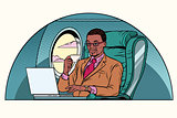 businessman working in the business class cabin