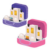 Pink and purple suitcases with perfume and cosmetics inside
