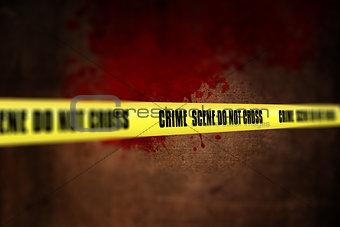 3D police line tape against defocussed blood splatter background