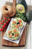 Avocado, cream cheese and tomato on wholemeal bagels