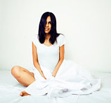 young pretty tann woman in bed among white sheets having fun, tr