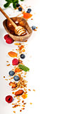Healthy breakfast -  Homemade granola, honey, milk and berries