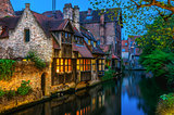 Medieval houses over canal in Bruges Belgium