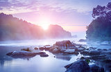 Landscape with sunrise and mist over river