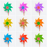 Collage of colorful pinwheels on white background