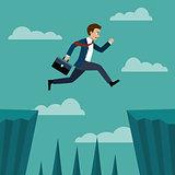 Businessman jumping over between the cliffs.