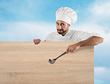 Chef with ladle and board
