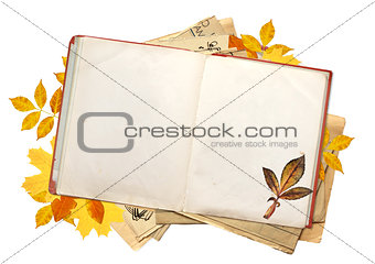 Old book with blank pages and multi-colored autumn leaves