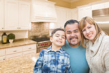 Young Mixed Race Family Having in Beautiful Custom Kitchen