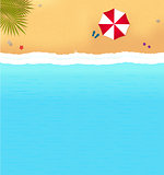 beach with waves and red umbrella